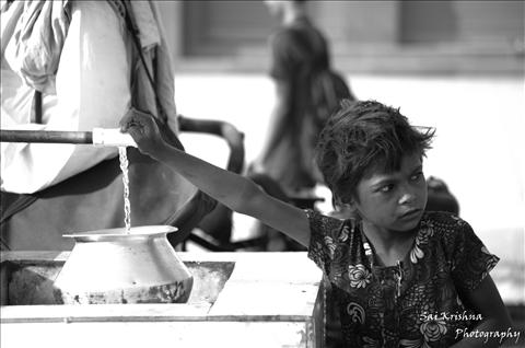Precious little thing.....water or the girl child????