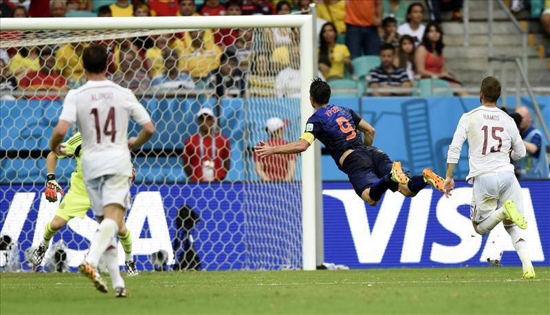 Robin van Persie of Netherland scoring a headball goal against Spain