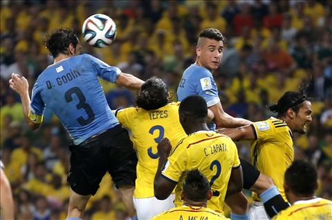 Uruguay's Diego Godin heads the ball during a match between Colombia and Uruguay