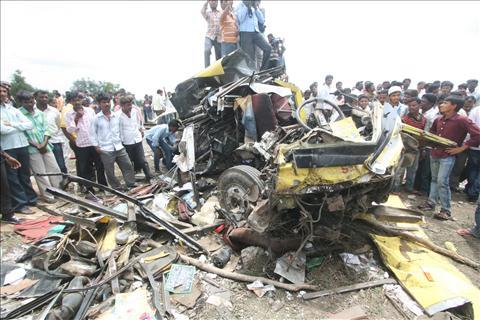 16 dead in school bus-train collision