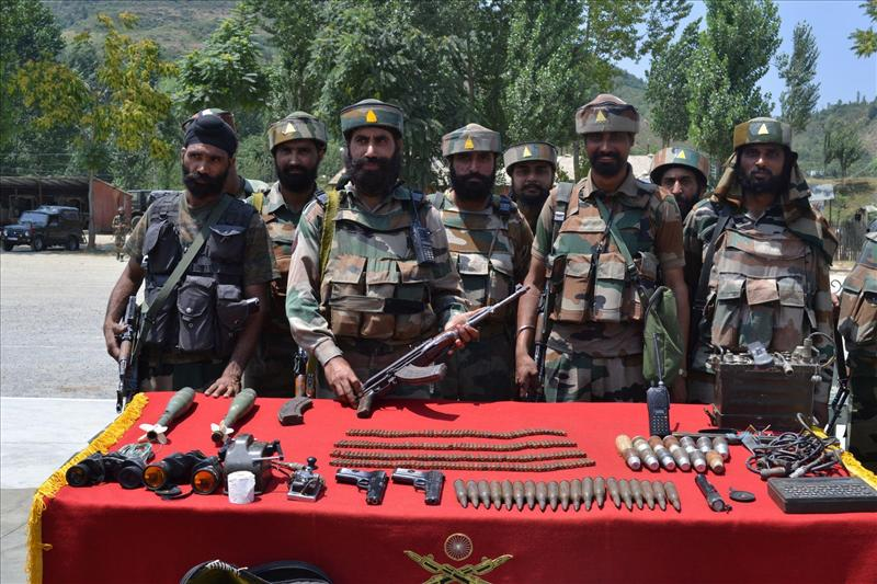 Arms and ammunition recovered from militants in Baramulla