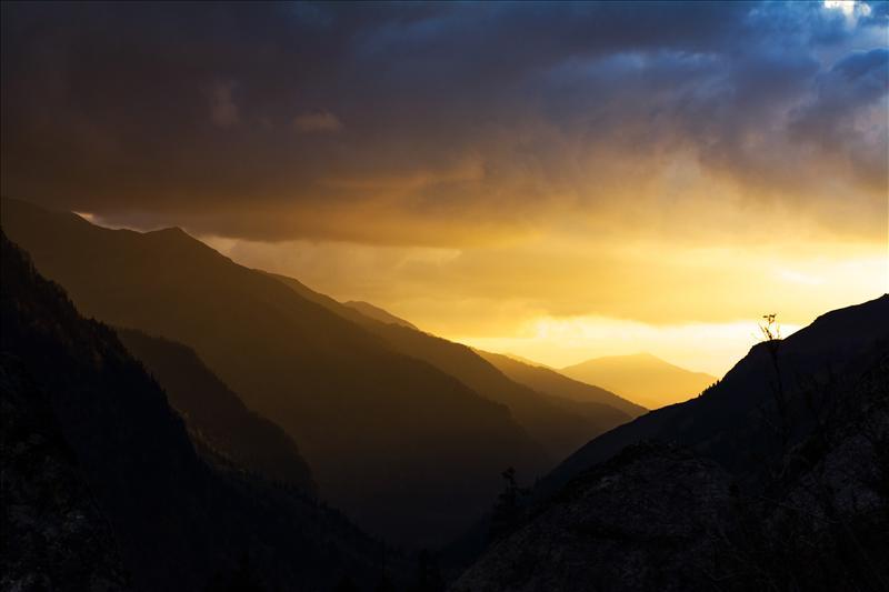 -Sunset through clouds