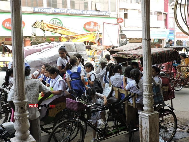 School children on Rickshaw