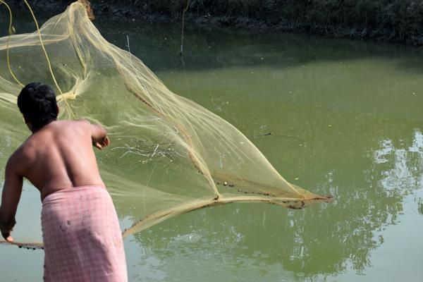 a fisherman is just ready with fish net