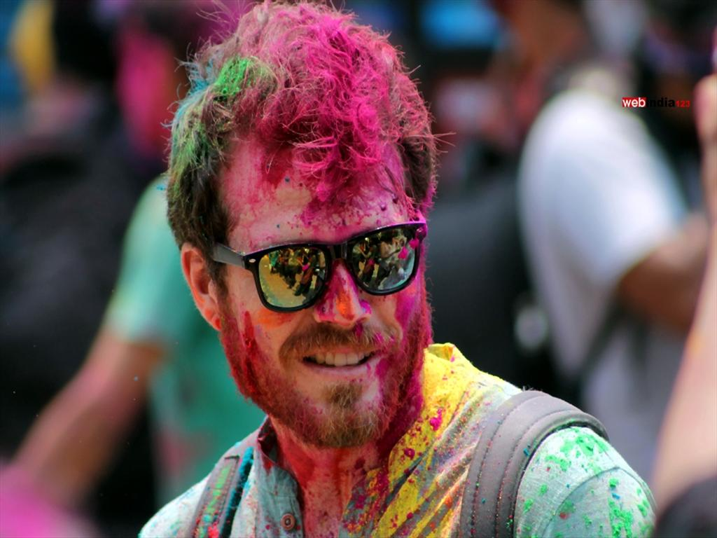 A Foreign tourist play Holi at Mattancherry