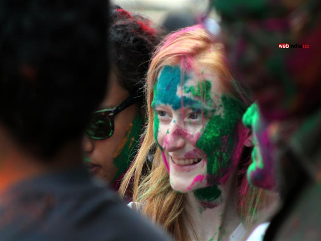 A Foreign tourist play Holi at Mattancherry