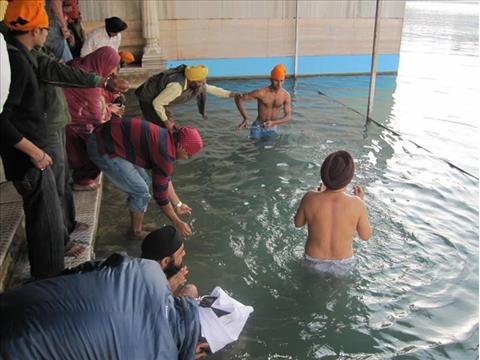 Bathing at the Holy Tank - Golden Temple