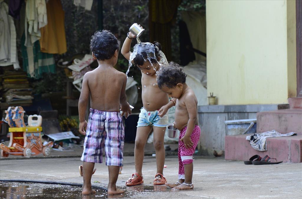 CHILDREN ENJOYING WATER GAME