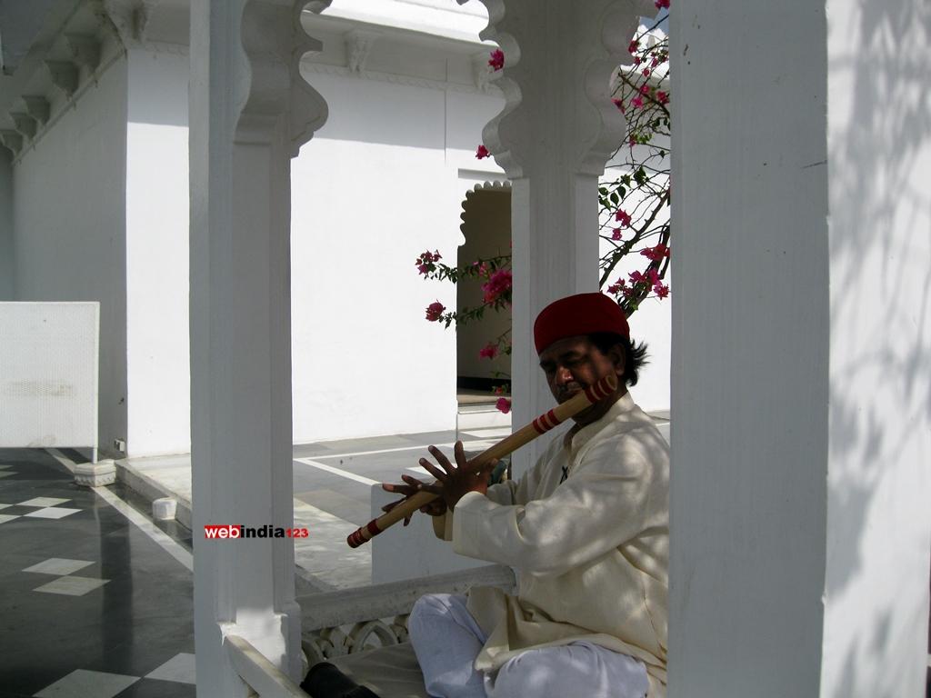 Artist Playing Flute at Taj Lake Palace Udaipur