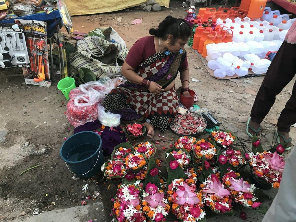 Woman Selling Flowers for Aarti  at Jai Ganga Maa Har Ki Pauri
