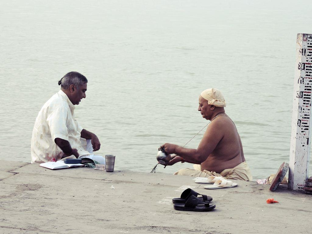 Pilgrims perform morning rituals in Holy Ganga River