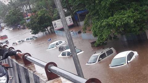 Rain+in+city